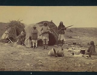 Photo Of Apaches In Camp With Rifles