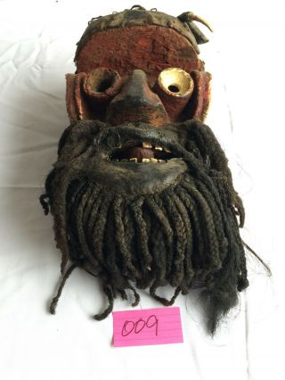 Kran,  Liberia.  Wood Carved Mask With Red Felt,  Charms And Other Accoutrements.
