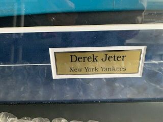 Derek Jeter signed Yankee stadium seat (2) and signed baseball shadowbox framed 5