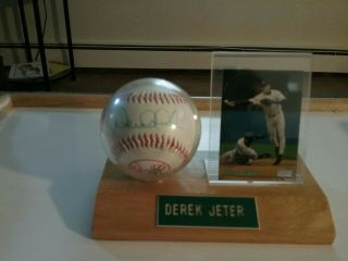 Derek Jeter Signed Yankee Baseball With Ball & Card Case.