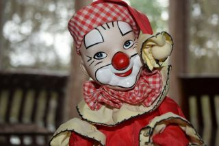 Vintage Porcelain Clown Rotating Wind Up Musical Doll Hand Painted Face Creepy