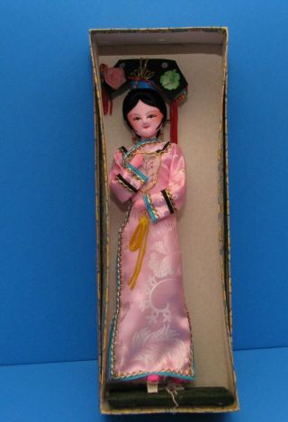 Vintage Plastic Doll Oriental Souvenir On Wooden Pedestal And