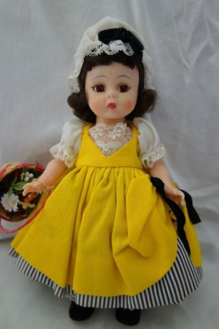 "1961 Madame Alexander French Doll - 8 "",  Hp,  Bk - W/yellow Dress,  Hat,  Flower Basket -"