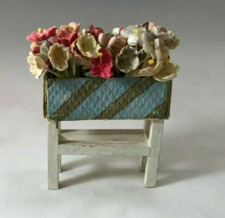 Vintage Plant Stand With Blue And Gold Embossed Paper Planter And Cloth Flowers